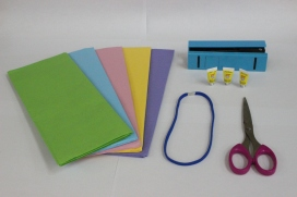 Gather your materials: one package of tissue paper of desired colors (the tissue paper used for gifts, not for blowing noses), a stapler, scissors, a pencil, liquid glue (a hot glue gun works better) and a headband (elastic, metal or plastic). A package of 50 sheets of tissue paper is available at The Dollar Tree or the 99 Cent Store.