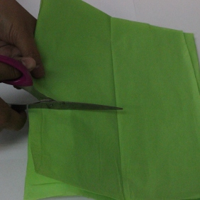 To make one flower, cut five to eight sheets of tissue paper into six by six inch squares and stack them on top of each other. Note, the smaller the sheets used, the smaller the flowers. Adding more sheets will create a fuller effect.