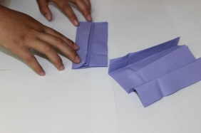 Fold the papers in a zig-zag pattern. Make sure that the width of the paper is no larger than one inch. However, take into consideration the length of the staples. Trim the edges into a curve to look like petals.