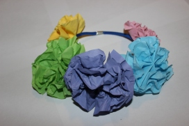 Let the glue dry for 10 minutes. Enjoy wearing the flower headband.