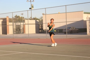Senior Demitria Mo returns the ball with a forehand, Oct. 20.PC: Karen La